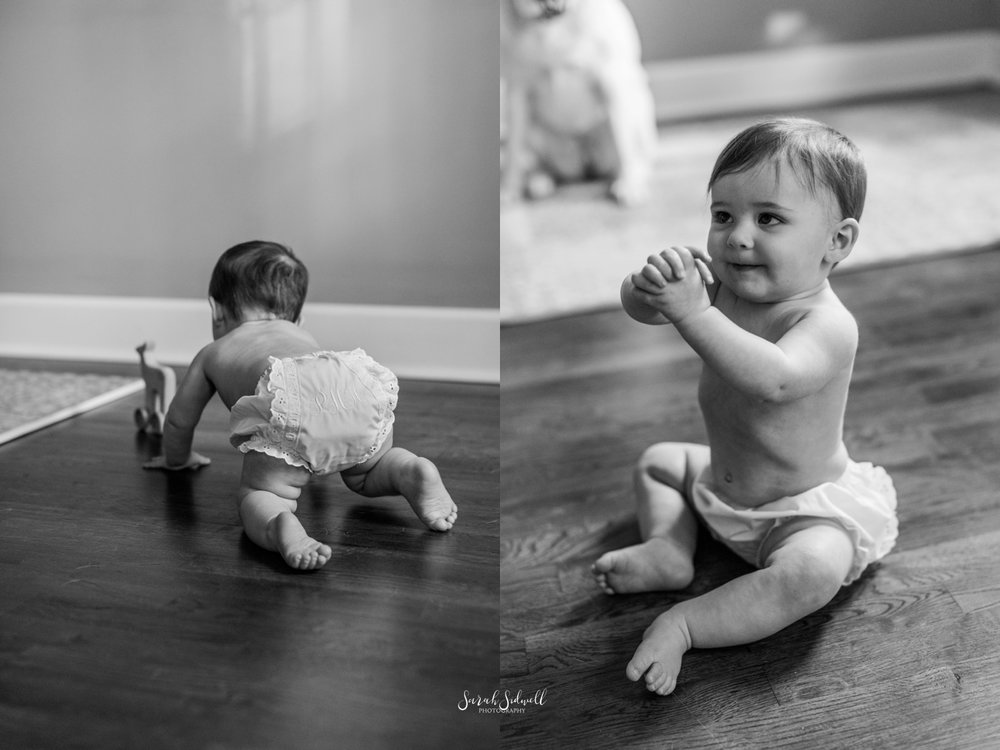 A baby crawls.