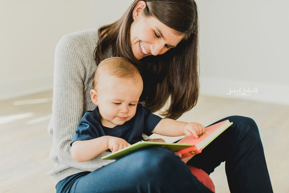 A mother reads to her baby. | Baby photography in Nashville.