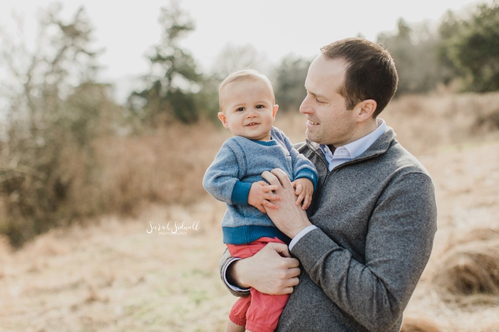 A man is holding his young son. | Baby Photography in Nashville.