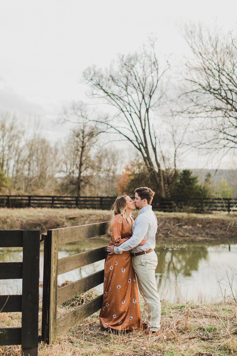 A couple kiss near a pond at Arrington Vineyards.