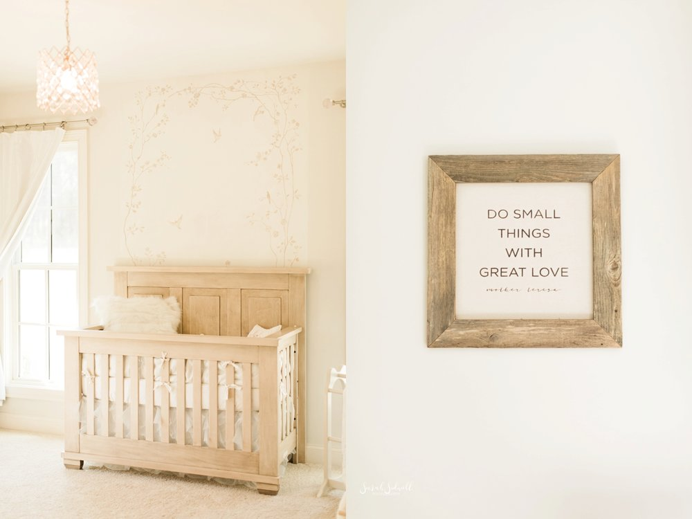 A crib is photographed in a nursery.