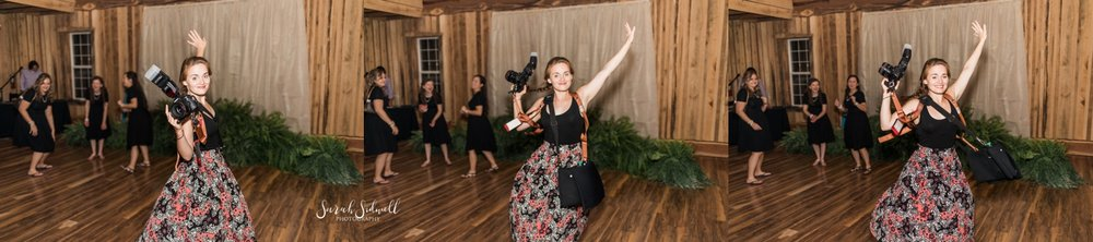 A photographer dances on a dance floor.