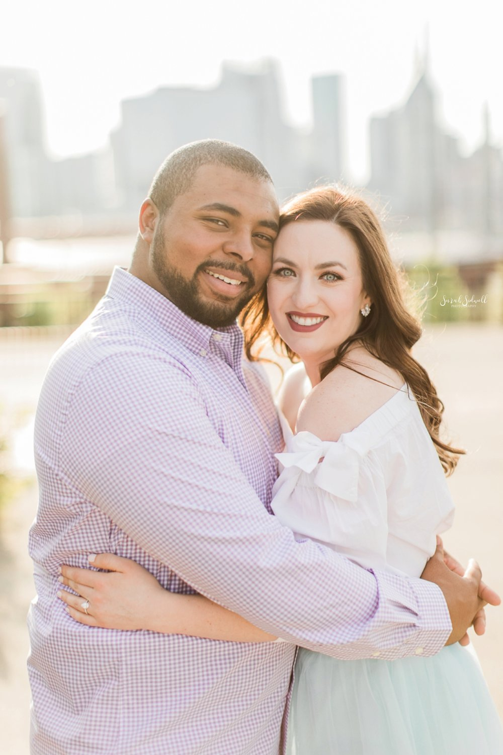 A couple embrace each other during their Engagement Photography session.