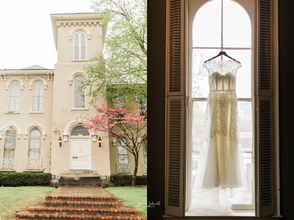 A dress hangs in front of the entrance to East Ivy Mansion.