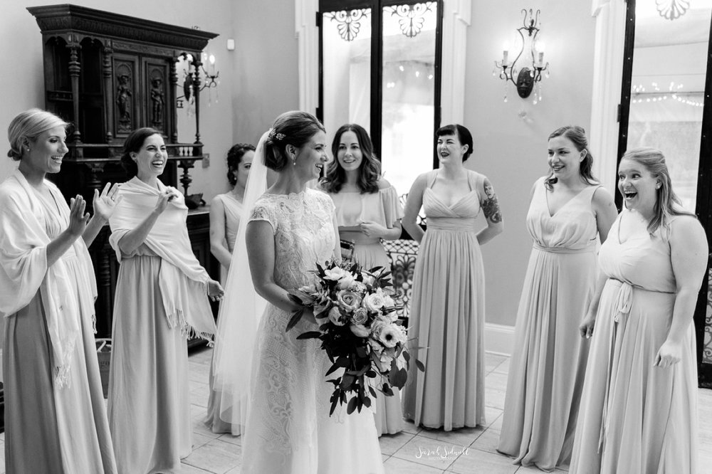 A bride stands among her bridesmaids.