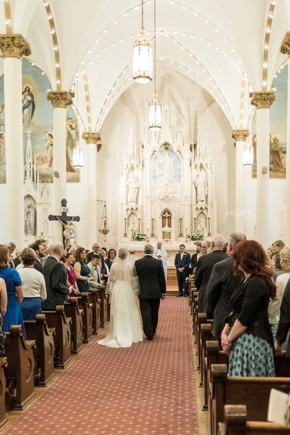A man walks his daughter down the aisle.