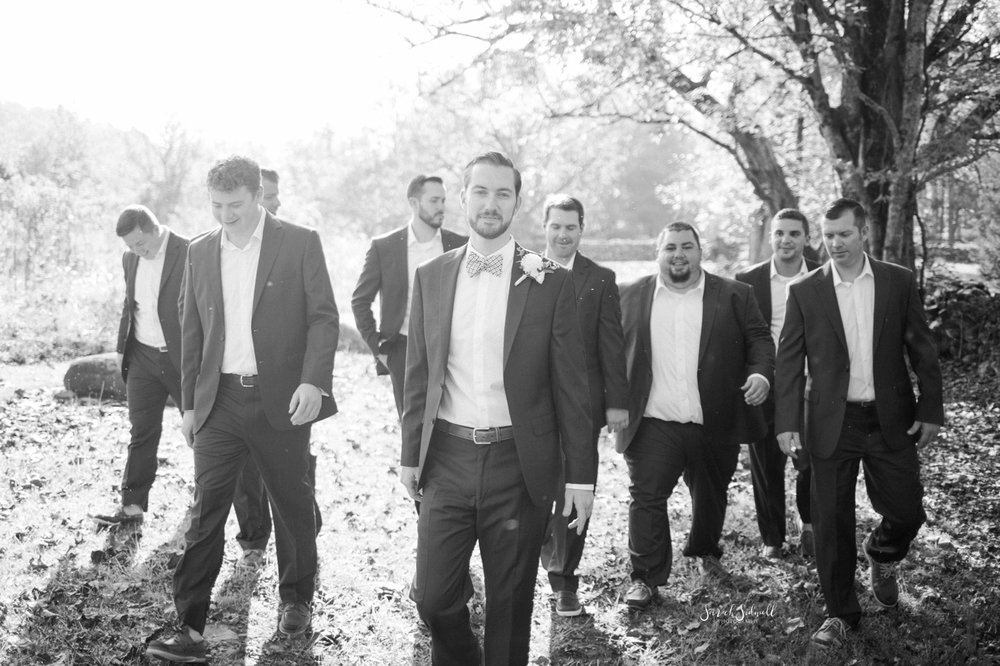 A groom stands with his groomsmen before the ceremony.