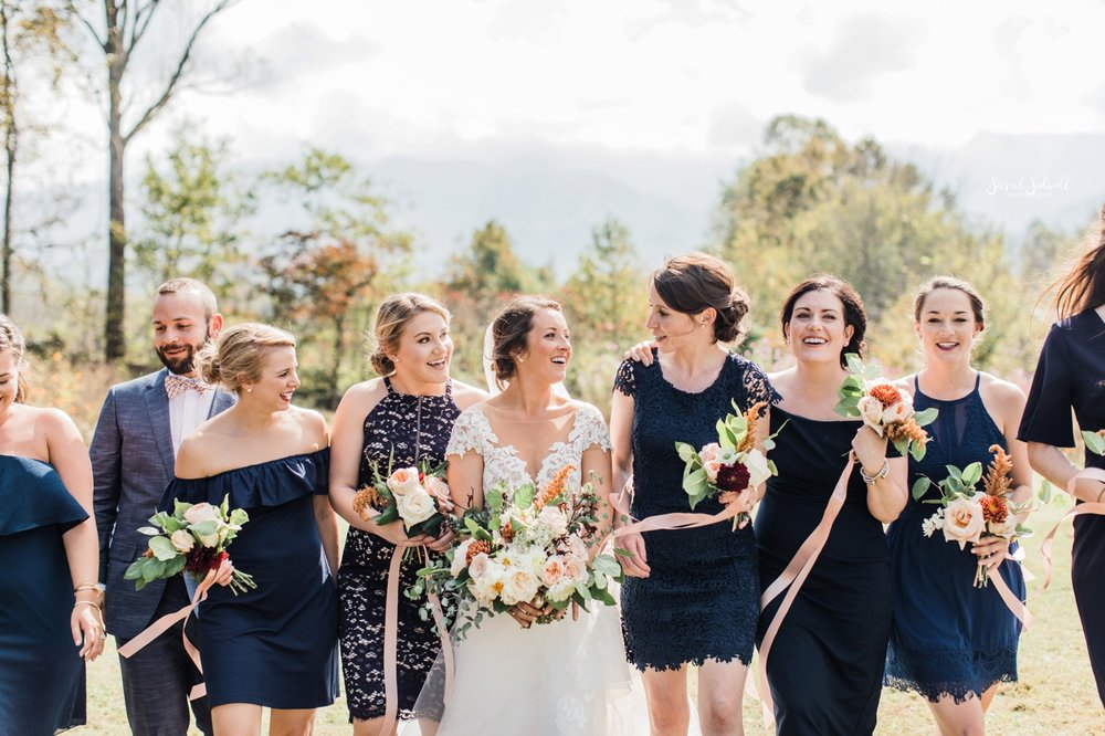 A bride is surrounded by her bridal party.