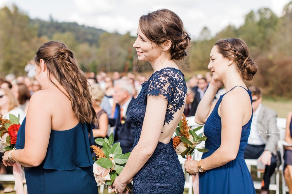 Bridesmaids cry as they watch the bride come down the aisle.