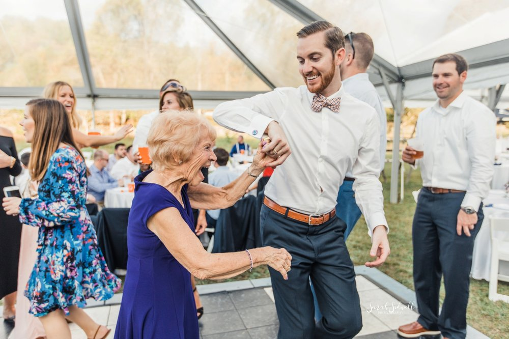 A groom dances with his mom at his wedding.
