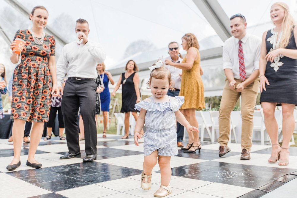 A child dances at a wedding reception.