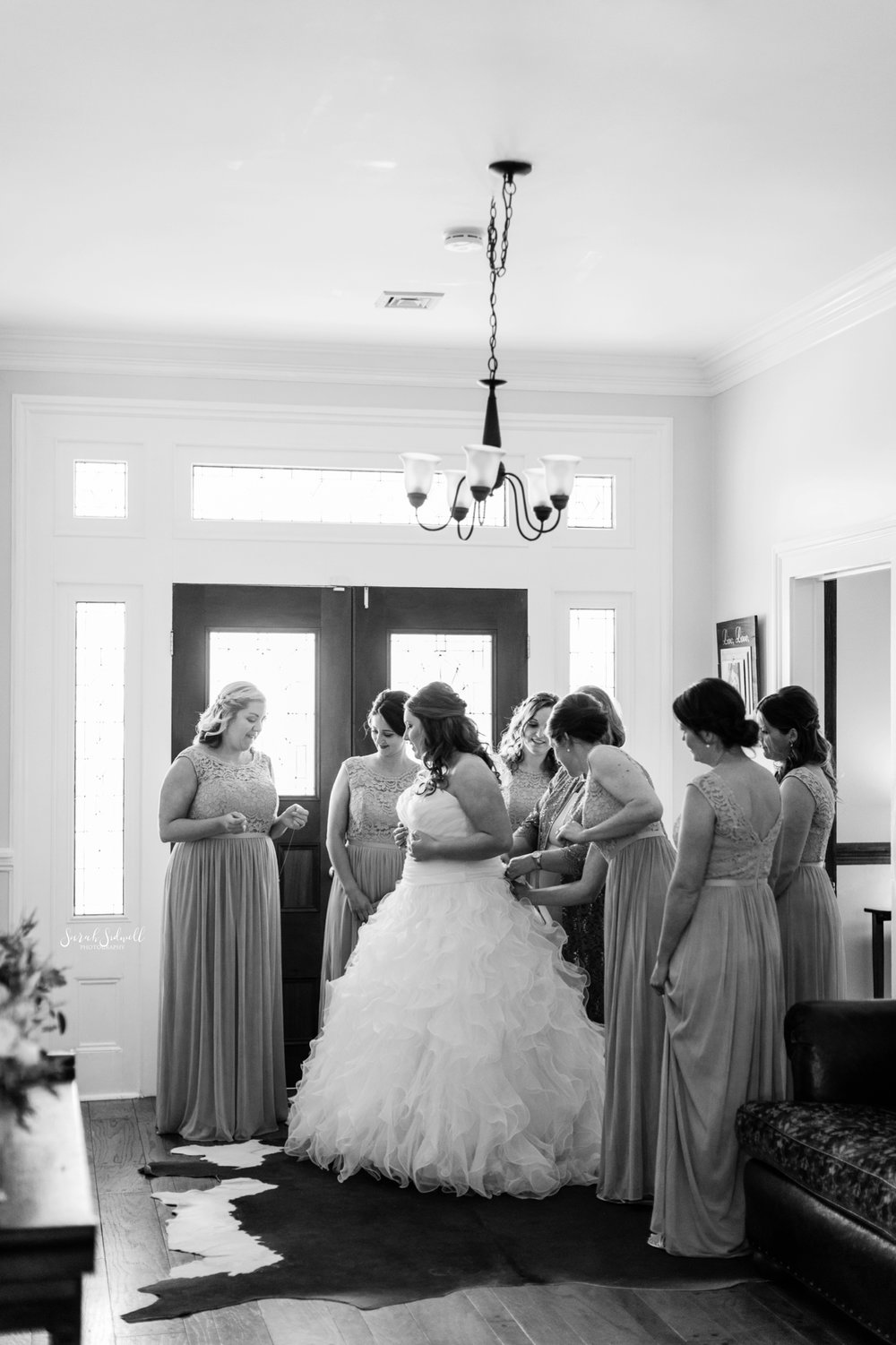 A bride gets ready for her wedding with her friends.