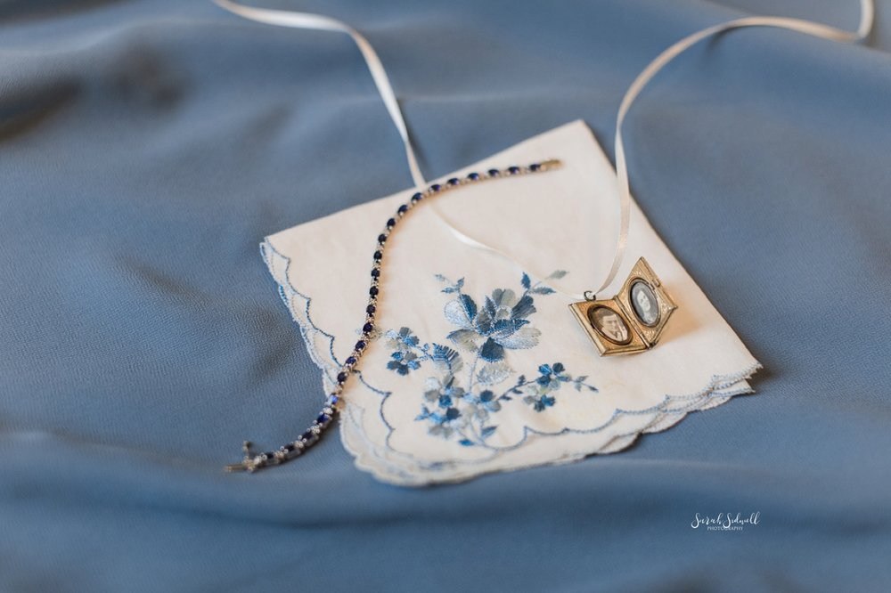 A cloth is embroidered with blue flowers for a bride's wedding day.