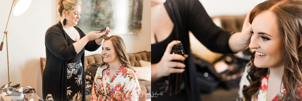 A bride has her hair done for her wedding day.