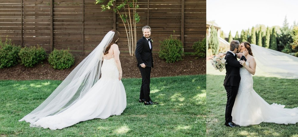 A bride wearing her wedding dress walks up to her groom.