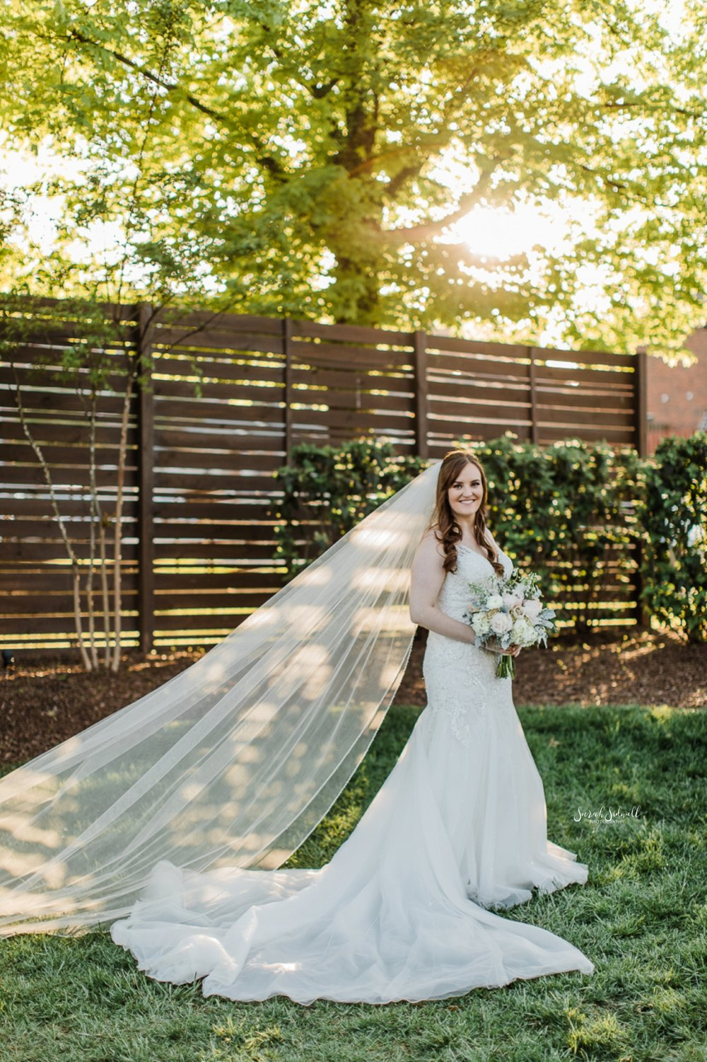 A bride poses for her Nashville Wedding Photos.