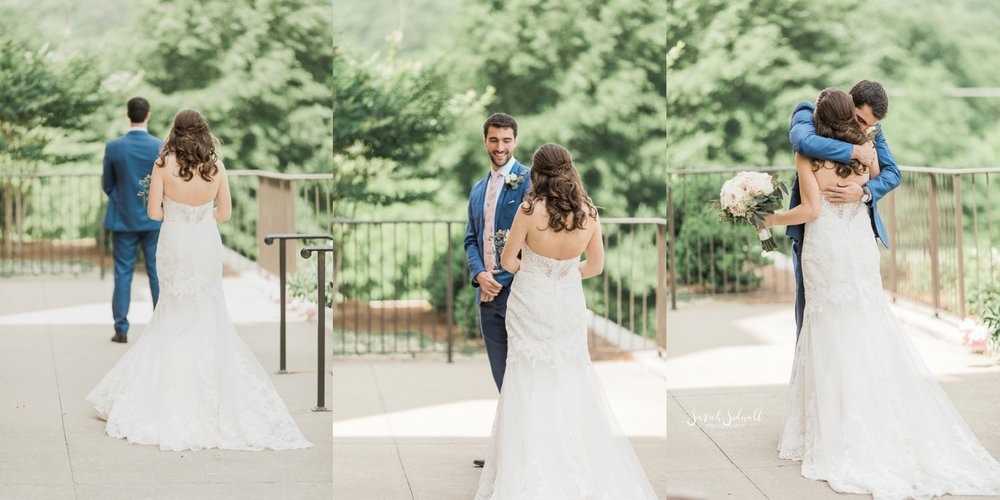 A bride takes a walk with her groom outdoors.