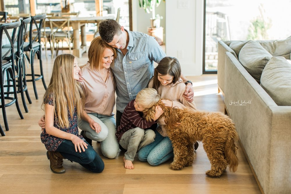 A Nashville family photographer captures a family petting their dog.