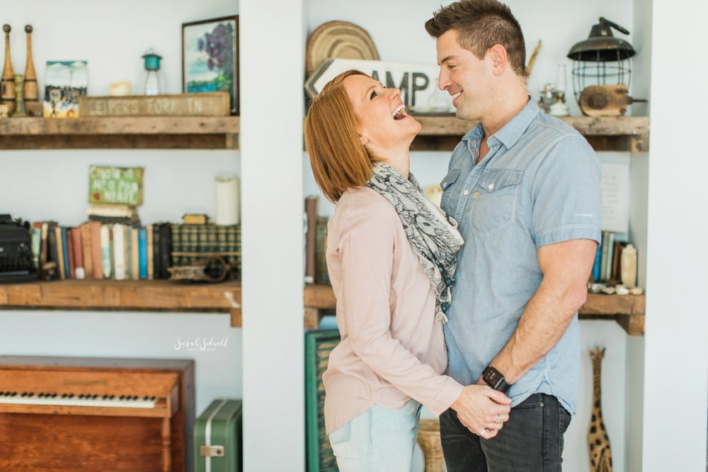 A Nashville family photographer captures a woman and her husband laughing together.