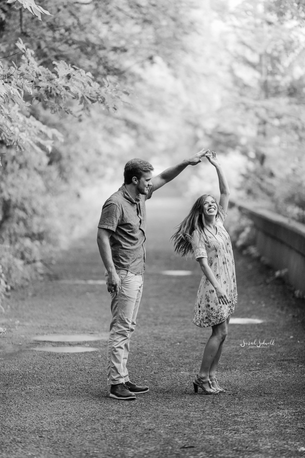 A couple dance on a dirt path at Radnor Lake.