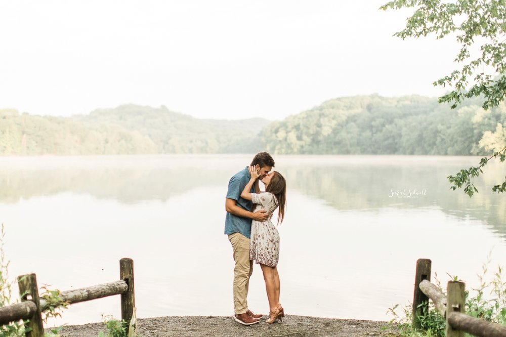 During their Radnor Lake engagement photographs, a couple kisses.