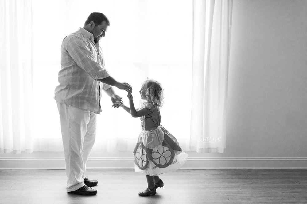 A man dances with his little girl for some Father And Daughter Pictures.