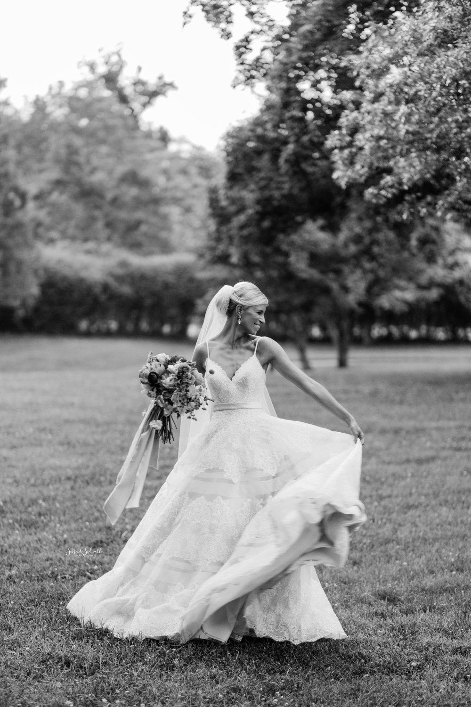 A bride twirls in her wedding dress.