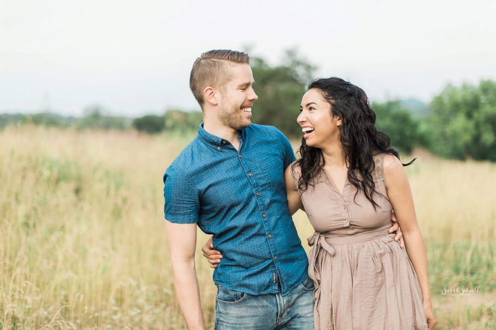 A couple share a giggle during their Anniversary Photography Session.