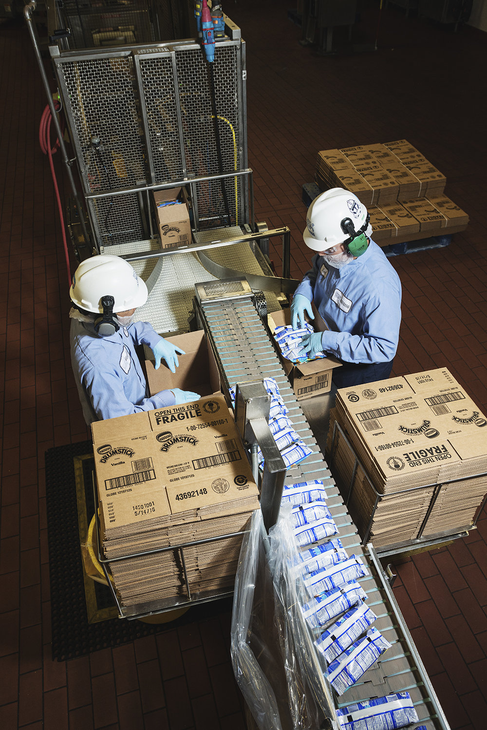 A series of photos for WIRED Magazine illustrating the process of making Nestle's Drumstick Ice creams. Photographs were taken at Nestle Headquarters in Bakersfield, CA.