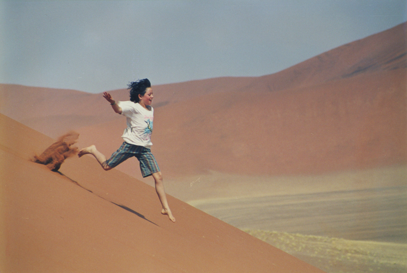 Running down the sand dunes in Namibia