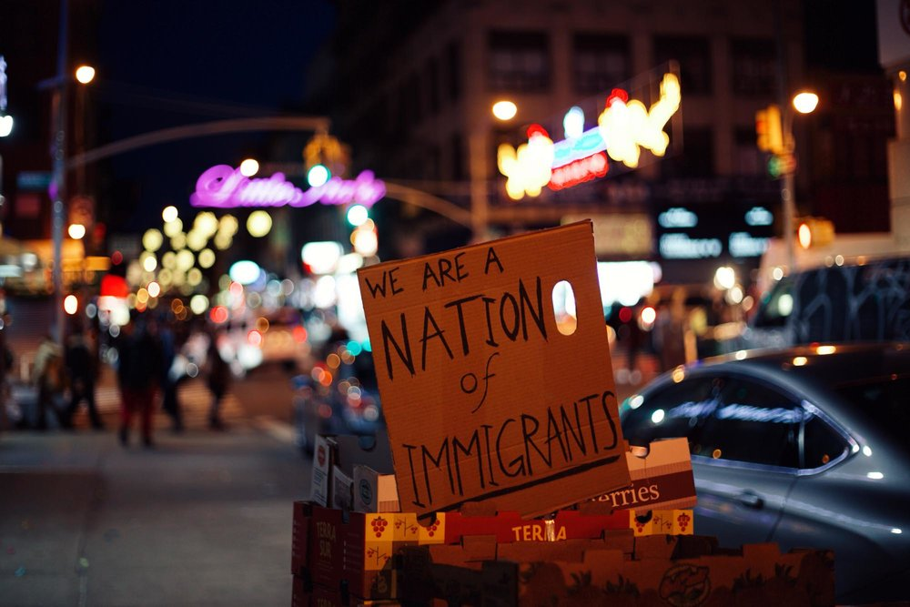 """We are a nation of immigrants"" – at the intersection of Little Italy and Chinatown.        try{(function() {if (typeof(lpcurruser) == 'undefined') lpcurruser = ''; if (document.getElementById('lpcurruserelt') && document.getElementById('lpcurruserelt').value != '') { lpcurruser = document.getElementById('lpcurruserelt').value; document.getElementById('lpcurruserelt').value = ''; } if (typeof(lpcurrpass) == 'undefined') lpcurrpass=''; if (document.getElementById('lpcurrpasselt') && document.getElementById('lpcurrpasselt').value != '') { lpcurrpass = document.getElementById('lpcurrpasselt').value; document.getElementById('lpcurrpasselt').value = ''; } var lploc=3;var lponlyfill=1;(function() { var doc=document; var _u=null; var _p=null; var body=doc.body; if (lploc==3 && body.className.indexOf('squarespace-login') =0) { var inps =doc.getElementsByName('password'); if (inps.length 0) { _p =inps[0]; } inps =doc.getElementsByName('email'); if (inps.length 0) { _u =inps[0]; }  if (lpcurrpass && _p) { _p.value = lpcurrpass; } if (lpcurruser && _u) { _u.value = lpcurruser; } } })();lpcurruser = ''; lpcurrpass = '';})();}catch(e){}"