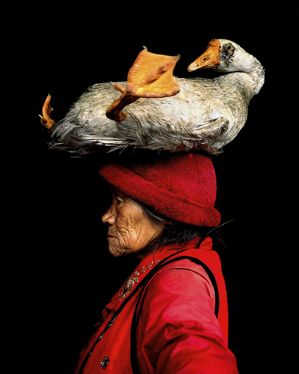 Lady with the Goose, Photo by Cristina Mittermeier (Yunnan Province, China)