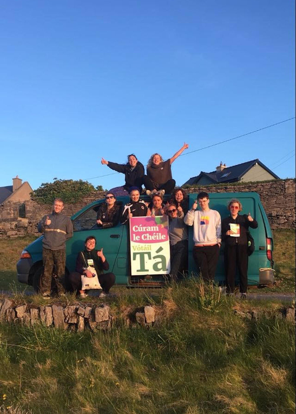 """Caring together by voting Yes"" reads a sign held up by participants at this year's Drop Everything on Inis Oírr. Photo: Mary Nally."