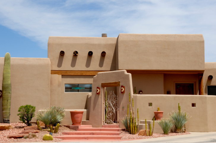 Buildings account for the largest portion of energy usage globally. A fantastic way to reduce that impact is by building with passive and local materials. This Adobe house is native to the desert. It uses a local mud brick and plaster for its walls which is more than plentiful in the region. An added benefit is the thickness of walls which control temperature inside the home, and reduce the amount of energy use. Photo from CC.