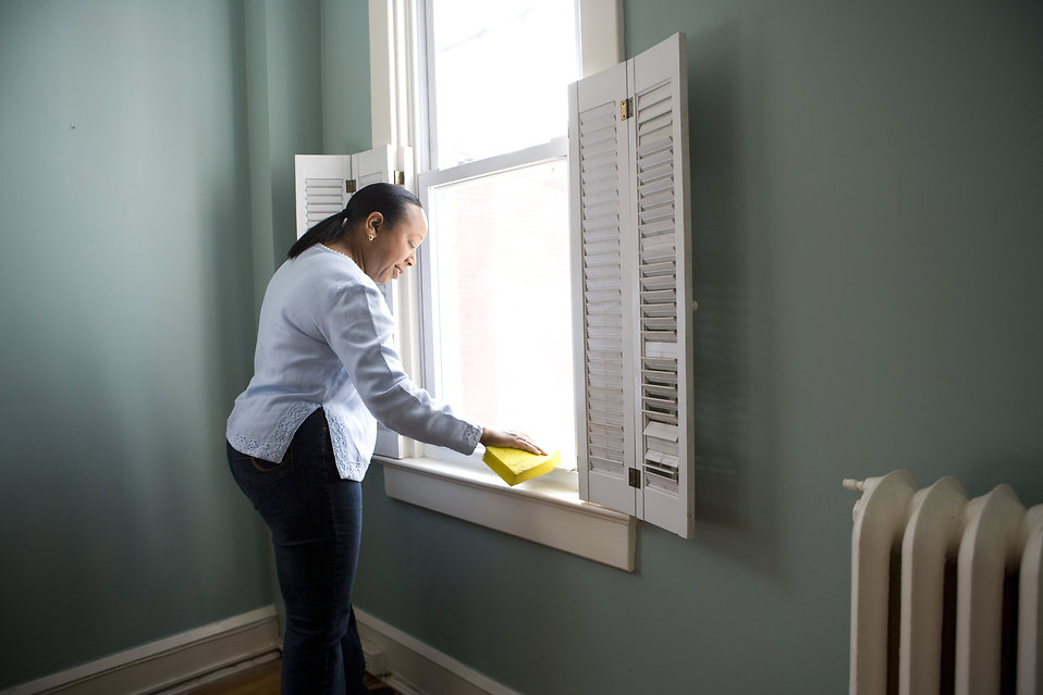 Fabrick-Design-Property Management_a woman-cleaning-a-window-pv (1).jpg
