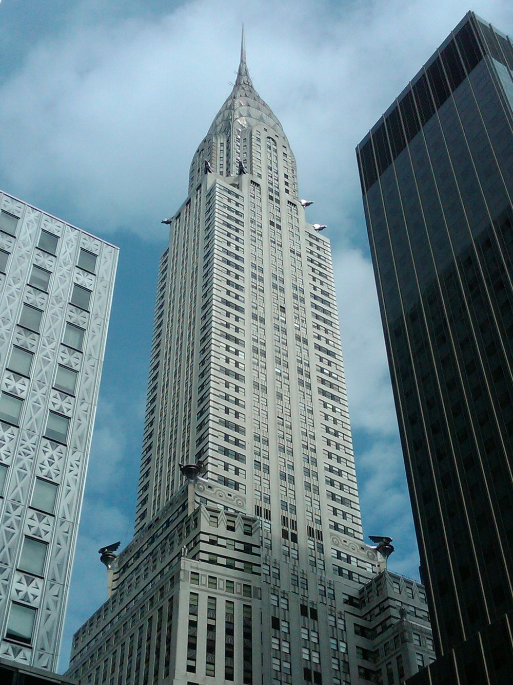 The Chrysler Building as seen from the street. As the building gets taller it has to set itself further back from the street creating the iconic stepped form.