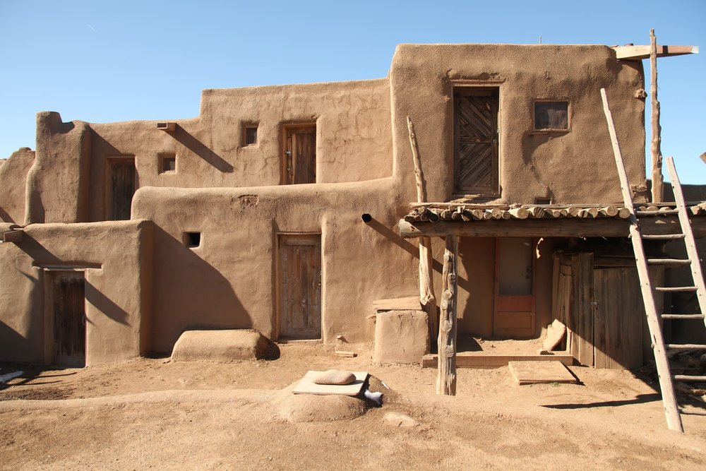 Adobe house clusters built by the Pueblo Native tribes which dominated the now Southwestern United States