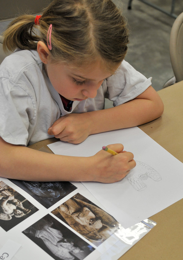 Carter, one of our avid artists is designing her angel using the photo references available.