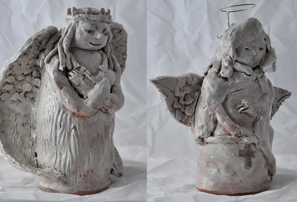 the finished angels in fired terracotta clay created by Carter (left) and Juah (right)
