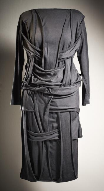 Rei  Kawakubo,  (b.1942)   and Comme des Garçons (Japan, born 1969). Woman's Dress, 1983. Costume/clothing principle attire/entire body, Wool jersey knit, Center back length: 45 in. (114.3 cm). Gift of Mary Levkoff in memory of Akira Kimura (AC1997.152.1)    Location:   Los Angeles County Museum of Art, Los Angeles, California, U.S.A.    Photo Credit:   Digital Image © [year] Museum Associates / LACMA. Licensed by Art Resource, NY    Image Reference:   ART526430