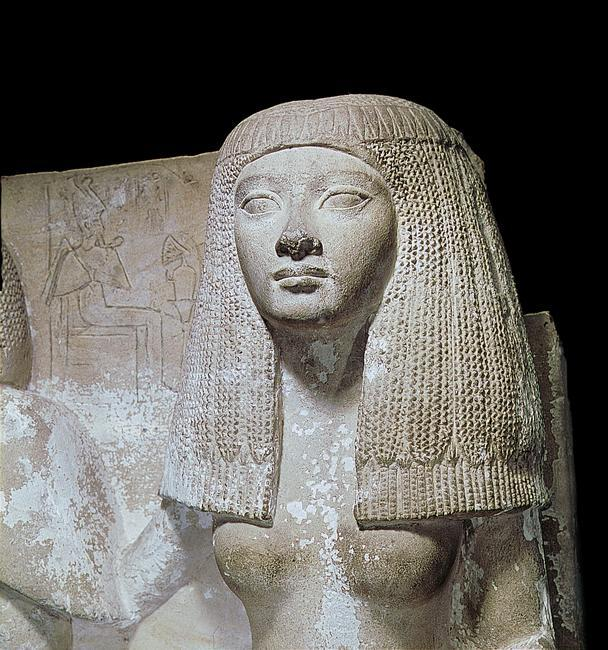 A detail of a portrait statue of Naia, sister of Thay. She wears a long wig. Country of Origin: Egypt. Culture: Ancient Egyptian. Date/Period: New Kingdom late 18 / early 19th dynasty c.1350-1320BC. Material Size: Limestone / H c.1m. Credit Line: Werner Forman Archive/ Egyptian Museum, Cairo . Location: 47.   Photo Credit:   HIP / Art Resource, NY    Image Reference:   AR9131033