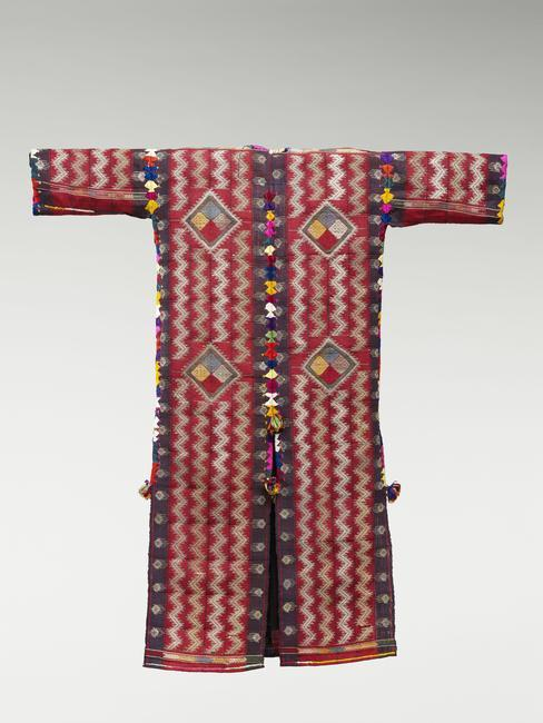 Woman's coat, back. Iraq. Culture: Kurdish, 1st half 20th CE. Part of a festive dress. Fine goat hair, silk, silver thread, embroidery, 132 x 121 x 6 cm. Inv. 70.2007.16.3. Photo: Michel Urtado / Thierry Ollivier.    Location:   Musee du Quai Branly, Paris, France    Photo Credit:   © musée du quai Branly - Jacques Chirac, Dist. RMN-Grand Palais / Art Resource, NY    Image Reference:   ART521788