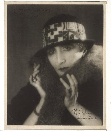 Man Ray (1890-1976) © ARS, NY   Marcel Duchamp as Rrose Sélavy, c. 1920-21. Gelatin silver print, 8 1/2 x 6 13/16 inches (21.6 x 17.3 cm). Signed in black ink, at lower right: lovingly / Rrose Sélavy / alias Marcel Duchamp [cursive]. The Samuel S. White 3rd and Vera White Collection, 1957.    Location:   Philadelphia Museum of Art, Philadelphia, U.S.A.    Photo Credit:   The Philadelphia Museum of Art / Art Resource, NY    Image Reference:   ART180545