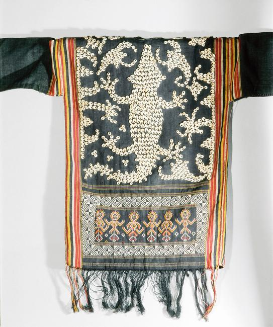 Cut-shell decorated jacket worn by Apo Kayan people at ceremonies connected with agriculture, warfare, and the commemoration of the dead. Back view showing image of lizard or crocodile. Country of Origin: Indonesia/ Sarawak. Culture: Apo Kayan Date/Period: 20th C. Place of Origin: Borneo. Material Size: Cotton and shell. Credit Line: Werner Forman Archive/ British Museum, London. Location: 05.    Photo Credit:   HIP / Art Resource, NY    Image Reference:   AR9131438