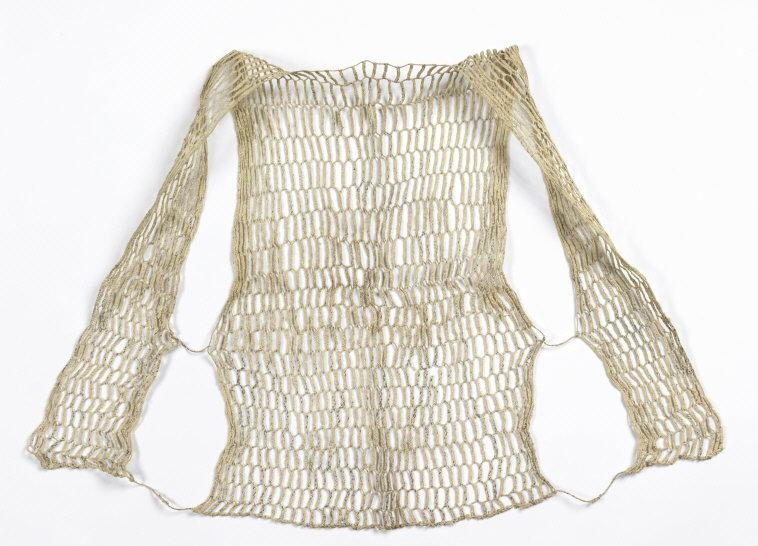 Sweat protector (koyori ase-hajiki). 1850-1860. Medium: paper; Technique: 4-strand plaiting with 2-strand twists. H x W: 62.2 x 52 cm (24 1/2 x 20 1/2 in.). Vest which opens at the front; fronts connected to back by two strands. Plaited recycled paper forming hexagonal mesh. Twisted strands are knotted at the bottom and middle of each side. Museum purchase from General Acquisitions Endowment Fund. 2009-36-2. Photo: Matt Flynn © Smithsonian Institution    Location:   Cooper-Hewitt, National Design Museum, New York, NY, U.S.A.    Photo Credit:   Cooper Hewitt, Smithsonian Design Museum / Art Resource, NY    Image Reference:   ART484268