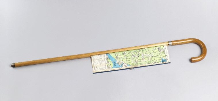 Cane with pull-out map. Produced by In-A-Cane Display Co. United States, 1940. Wood, metal, coated fabric, plastic. 87x7 x 12.8 x 2.5 cm (34 1/2 x 5 1/16 x 1 in.). gift of Joh B. Scholz in memory of Walter Scholz, 1987-97-10. Photo: Matt Flynn, © Smithsonian Institution    Location:   Cooper-Hewitt, National Design Museum, New York, NY, USA    Photo Credit:   Cooper Hewitt, Smithsonian Design Museum / Art Resource, NY    Image Reference:   ART394493