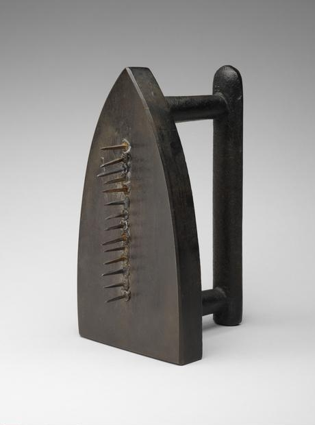Ray  Man , (1890-1976) © ARS, NY    Cadeau  (Gift), 1963 (1921 original now lost). Flatiron and 14 iron tacks, 15.8 x 9 x 9 cm. Through prior gift of Mrs. Gilbert W. Chapman, 2009.129.    Location:   The Art Institute of Chicago, Chicago, U.S.A.    Photo Credit:   The Art Institute of Chicago / Art Resource, NY    Image Reference:   ART528466