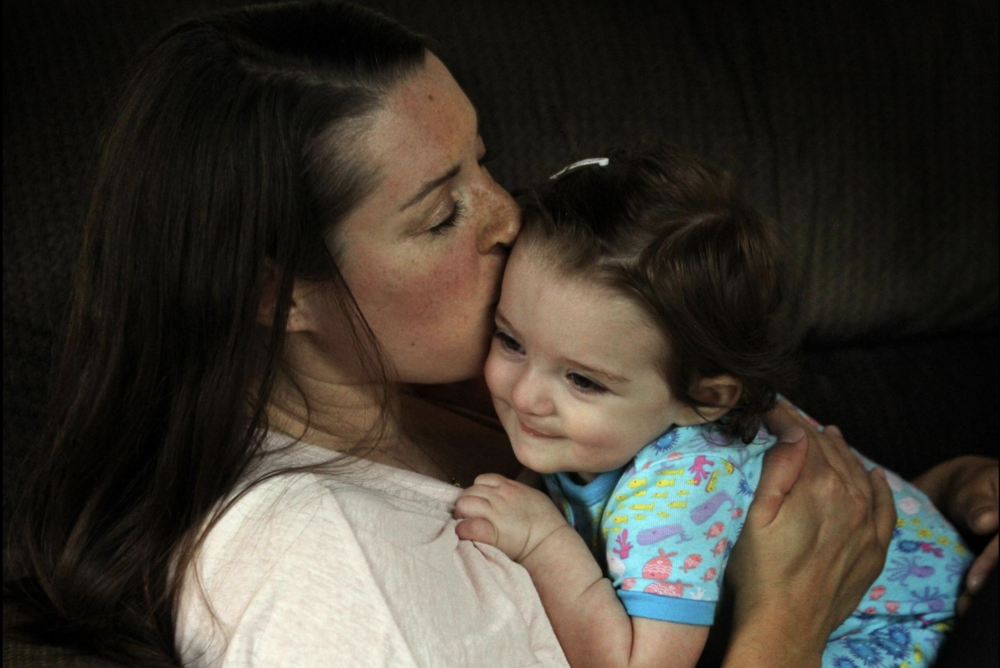 """Kristin Ritchotte with her daughter, Lorelei """"Rory"""" Ritchotte after Rory woke up on a recent morning [ The Providence Journal /Bob Breidenbach)"""