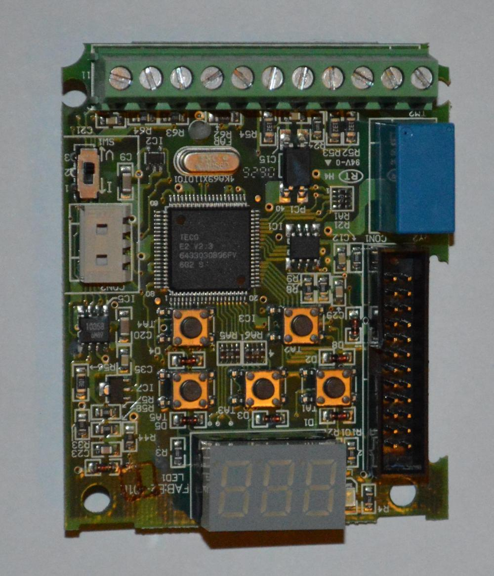 Controller board. Th e  TQFP packaged chip is the controller. The screw terminals at the top are available for connection of external I/O. The blue component to the top right is a relay used for digital output.