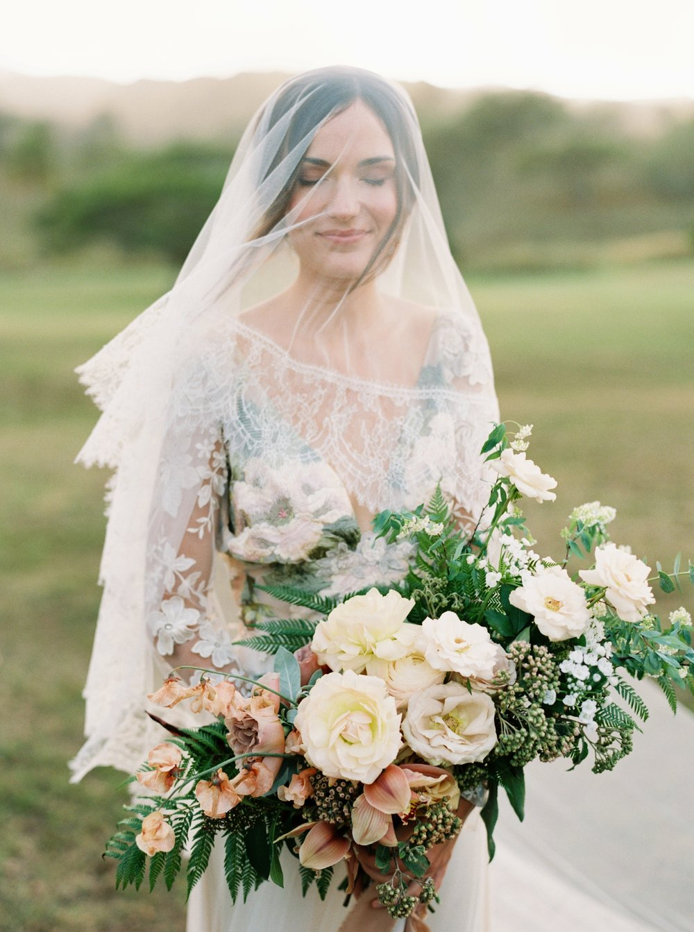 Bride with bouquet and veil on top